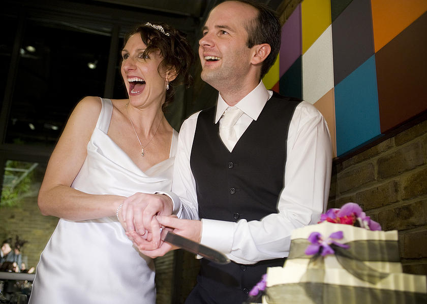 Full of joy as Kelly and Toby cut their wedding cake.