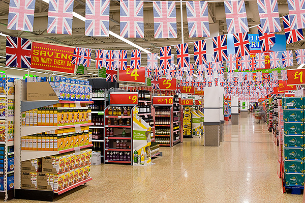 Bunting in the central aisle of Asda, Swanley. Only the prices seem to have changed in a scene out of the 70s. April 29, 2011. Photo © Michael Cockerham