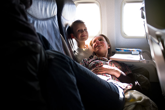 Laura and Joshua relax in flight.
