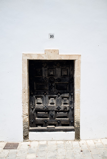 Door in white wall.