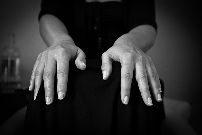 The bride's hands while she is made up.