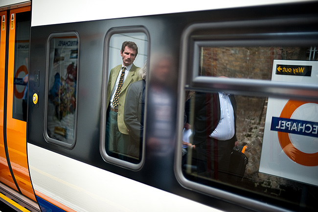 Reflection of man waiting for train