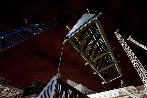 Once lifted from the wagon, the section is raised to the roof by a 600 tonne crane.