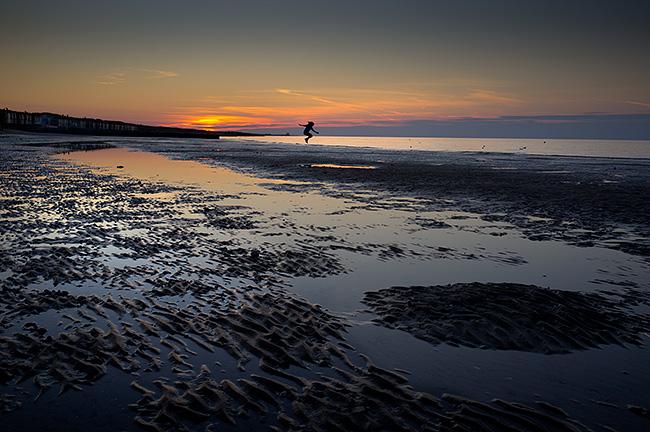 Minnis Bay X100 sunset jumping girl