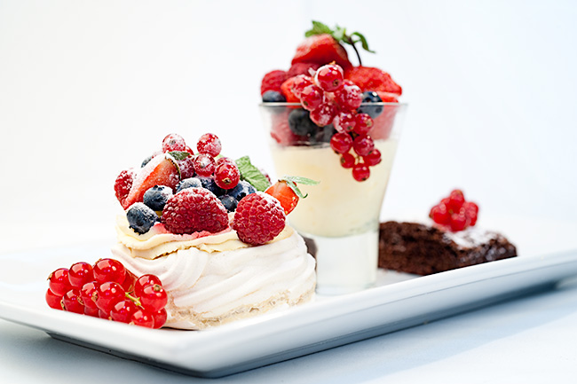 three part dessert with strawberrys and redcurrants