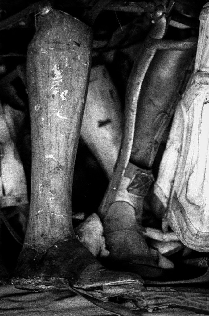 Some of the prosthetic limbs removed from Auschwitz inmates. Photo: © Michael Cockerham 1993.